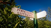 Poinciana Cottages sign